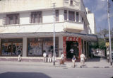 Tanzania, pedestrians walking in front of shop in Dar es Salaam