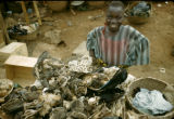Nigeria, merchant selling plant and animal parts for fetishes