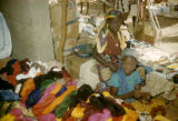 Nigeria, Fula children selling yarn and textiles