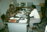 Nigeria, business men meeting in office