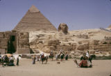 Egypt, tourists at Great Sphinx and Pyramids in Giza