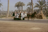 Egypt, people riding horse-drawn cart near Memphis ancient city