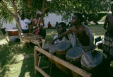 Zambia, men playing xylophone and drums at Makishi masquerade performance