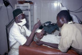 Nigeria, man administering anesthesia to patient in Hospital