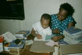 Nigeria, primary school teacher with student