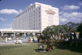 Zambia, people gathered by pool at Hotel Intercontinental Lusaka