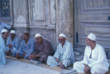 Cairo (Egypt), men sitting together along the sidewalk