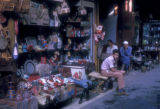 Cairo (Egypt), men sitting by the display of their merchandise