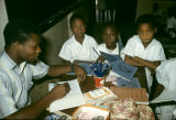 Nigeria, primary school teacher with students