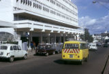 Uganda, automobiles in front of building in Kampala