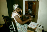 Democratic Republic of the Congo, female telephone operator at switchboard