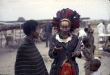 Democratic Republic of the Congo, shaman talking with person smoking pipe