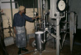 Democratic Republic of the Congo, worker operating machinery at factory