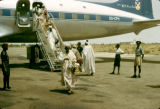 Nigeria, passengers departing plane at Kano Airport