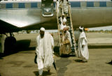 Nigeria, passengers departing plane at airport