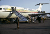 Uganda, passengers disembarking East African airplane at Kampala Airport