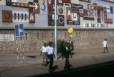 Uganda, pedestrians in front of Bank of India in Kampala