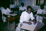 Nigeria, adult students at desks in classroom