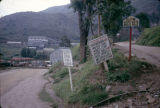 Uganda, signs at street leading to Kilembe Copper Mine