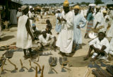 Nigeria, merchants selling farm tools at market