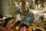 Nigeria, young shopkeepers selling yarn