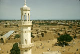 Nigeria, view of Kano beyond minaret of Central Mosque of Kano