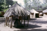 Zambia, thatched-roof open structure in village