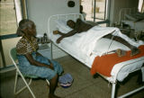Africa, woman visiting sick person in hospital