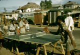 Nigeria, boys playing ping pong outdoors