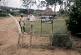 Uganda, men talking at entrance to Murchison Falls National Park