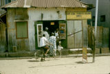 Nigeria, people outside typewriter repair service