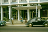 Ghana, pedestrians walking past Cocoa House in Accra
