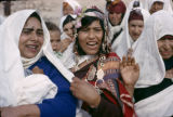Tunisia, Bedouin bride carrying child in wedding procession