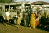 Ghana, people gathered at village bus in Accra