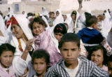 Tunisia, Bedouin women and children walking in wedding procession