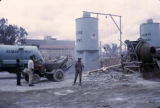 Kenya, men working in yard of cement plant in Nairobi