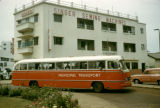 Ghana, public bus passing by Singer Sewing Machines building in Accra