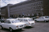 Kenya, cars parked in front of modern building in Nairobi