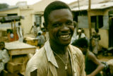Ghana, portrait of smiling man in Accra