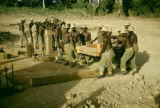 Ghana, group of Ashanti men working on bridge construction project