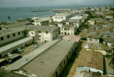 Ghana, view of rooftops in Accra and Gulf of Guinea