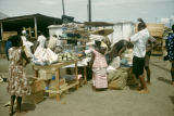 Ghana, fabric sellers at outdoor market in Accra