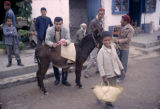 Tunisia, street scene with young men and donkey