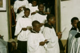 Ghana, choirboys singing as they exit church