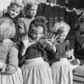 Netherlands, group of children wearing traditional costume in Volendam