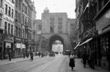 Germany, street scene and city gate in Cologne