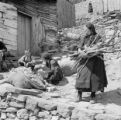 Greece, women and boy working outside home in Métsovon