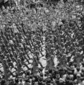 Spain, military parade in crowded plaza in Seville