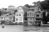 Greece, houses along river in Athens