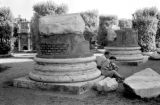 Italy, couple resting at column ruins in Rome
